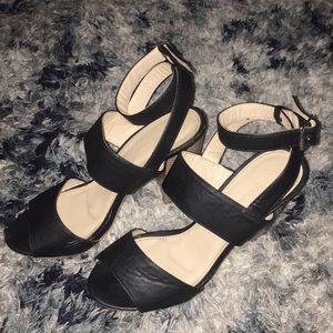 Black strapped snarled heels